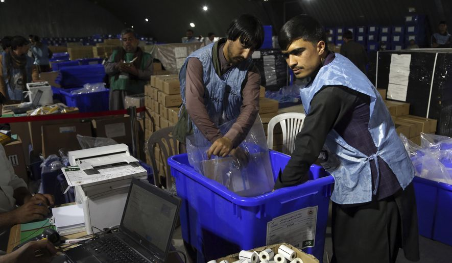 Election commission workers prepare ballot boxes and election materials for the presidential election scheduled for Sept 28, at the Independent Election Commission compound in Kabul, Afghanistan, Sunday, Sept. 15, 2019. Afghan officials say around 100,000 members of the country's security forces are ready for polling day. (AP Photo/Rahmat Gul)