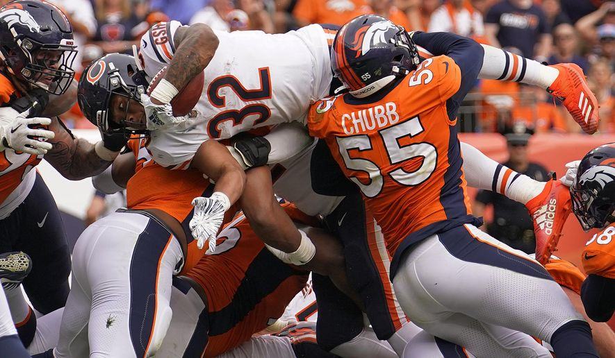 Chicago Bears running back David Montgomery (32) dives in for the touchdown as Denver Broncos outside linebacker Bradley Chubb (55) blocks during the second half of an NFL football game, Sunday, Sept. 15, 2019, in Denver. (AP Photo/Jack Dempsey)