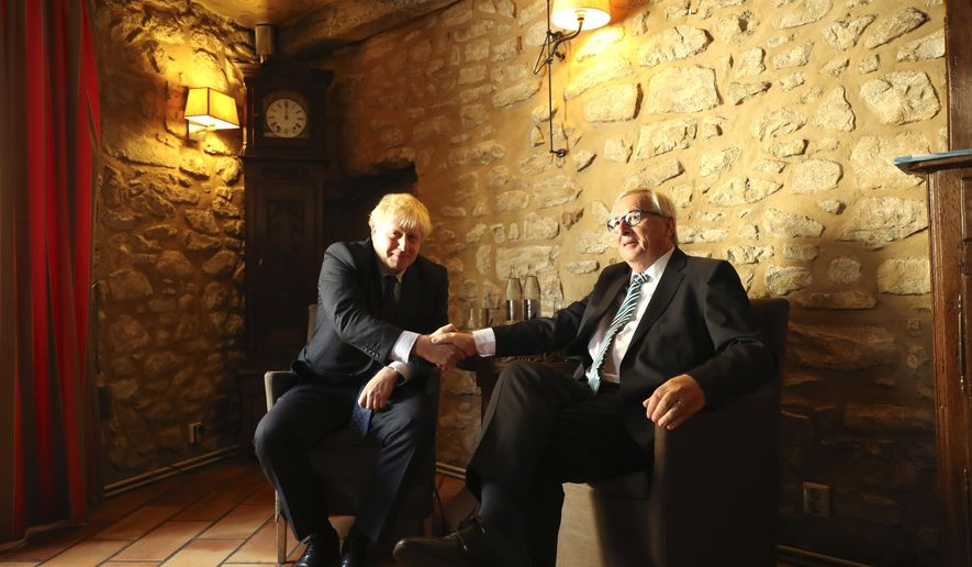 European Commission President Jean-Claude Juncker, right, shakes hands with British Prime Minister Boris Johnson prior to a meeting at a restaurant in Luxembourg, Monday, Sept. 16, 2019. British Prime Minister Boris Johnson was holding his first meeting with European Commission President Jean-Claude Juncker on Monday in search of a longshot Brexit deal. (AP Photo/Francisco Seco, Pool)