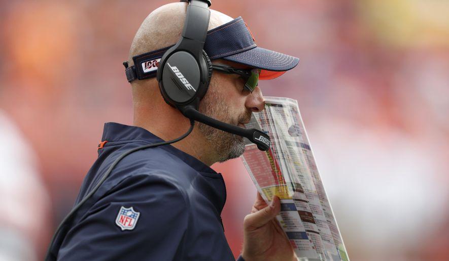 Chicago Bears head coach Matt Nagy makes a call against the Denver Broncos during the first half of an NFL football game, Sunday, Sept. 15, 2019, in Denver. (AP Photo/David Zalubowski)