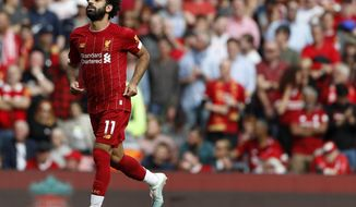 Liverpool's Mohamed Salah celebrates after scoring his sides third goal during the English Premier League soccer match between Liverpool and Newcastle at Anfield stadium in Liverpool, England, Saturday, Sept. 14, 2019. (AP Photo/Rui Vieira)