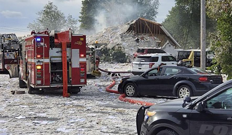 Emergency vehicles are at the scene of a deadly propane explosion, Monday, Sept. 16, 2019, which leveled new construction in Farmington, Maine. (Jacob Gage via AP)