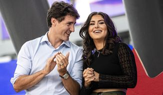 Canadian Prime Minister and Liberal leader Justin Trudeau speaks with Canadian tennis player and U.S. Open winner Bianca Andreescu on stage during a rally for her in Mississauga, Ontario, Sunday, Sept. 15, 2019. (Christopher Katsarov/The Canadian Press via AP)