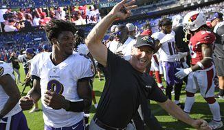 Baltimore Ravens quarterback Lamar Jackson, left, celebrates with head coach John Harbaugh after an NFL football game against the Arizona Cardinals, Sunday, Sept. 15, 2019, in Baltimore. Baltimore won 23-17. (AP Photo/Nick Wass)