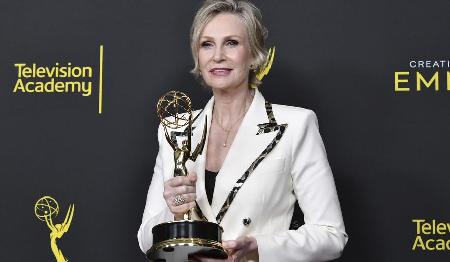 """CORRECTS THE DATE TO SUNDAY, SEPT. 15 -  Jane Lynch poses in the press room with the award for outstanding guest actress in a comedy series for """"The Marvelous Mrs. Maisel"""" on night two of the Creative Arts Emmy Awards on Sunday, Sept. 15, 2019, at the Microsoft Theater in Los Angeles. (Photo by Richard Shotwell/Invision/AP)"""