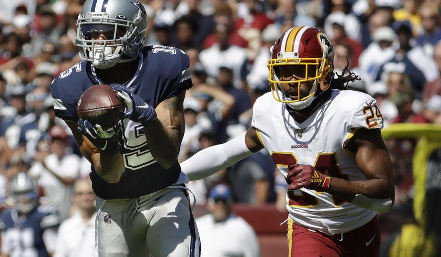 Dallas Cowboys wide receiver Devin Smith makes a catch and goes on to score against Washington Redskins cornerback Josh Norman (24) in the first half of an NFL football game, Sunday, Sept. 15, 2019, in Landover, Md. (AP Photo/Evan Vucci)