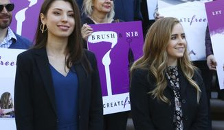 FILE - This Jan. 22, 2019 file photo shows Christian artists Joanna Duka, front left, and Breanna Koski, front right, outside the Arizona Supreme Court after justices heard arguments over Phoenix's anti-discrimination ordinance that bars businesses from refusing service to same-sex couples for religion reasons. Duka and Koski, who operate a business that makes invitations and other wedding-related items, had challenged the constitutionality of the ordinance. On Monday, Sept. 16, 2019 the state Supreme Court said the free speech rights of Duka and Koski were violated by the ordinance. (AP Photo/Ross D. Franklin,File)