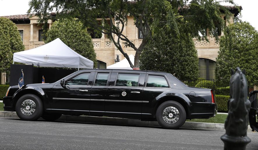 FILE - In this April 5, 2019, file photo, the presidential limousine of President Donald Trump is parked on a hill in front of a private residence in Beverly Hills, Calif., as he meets with supporters during a fundraiser. Trump is set to raise more than $15 million this week during a two-day California fundraising swing. (AP Photo/Jacquelyn Martin, File)