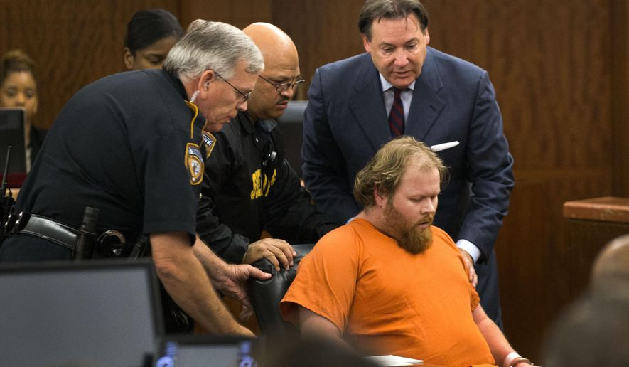 FILE - In this July 11, 2014 file photo, Ronald Lee Haskell collapses as he appears in court in Houston. A forensic psychiatrist told jurors Monday, Sept. 16, 2019, that Haskell, accused of fatally shooting six members of his ex-wife's family was not responsible for his actions because of severe mental illness that made him believe voices in his head were telling him to carry out the killings. The psychiatrist was expected to be the final witness from defense attorneys for Haskell, who is charged with capital murder in the July 2014 attack in a suburban Houston home. (Brett Coomer/Houston Chronicle via AP, Pool)