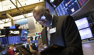 John Wilson, with the New York Stock Exchange, monitors stock activity, Monday, Sept. 16, 2019. Global stock markets sank Monday after crude prices surged following an attack on Saudi Arabia's biggest oil processing facility. (AP Photo/Mark Lennihan)
