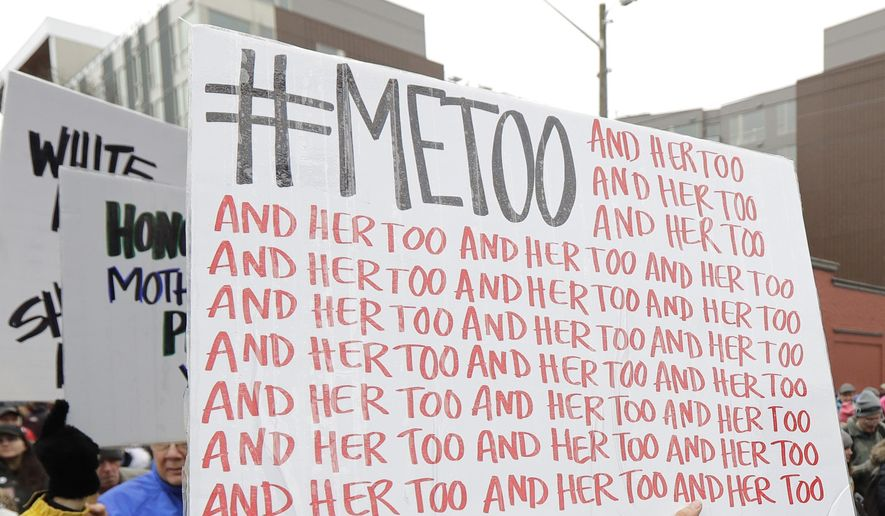 In this Jan. 20, 2018, file photo, a marcher carries a sign with the popular Twitter hashtag #MeToo used by people speaking out against sexual harassment as she takes part in a Women's March in Seattle. According to a study published Monday, Sept. 16, 2019, the first sexual experience for many U.S. women was forced or coerced intercourse in their early teens, encounters that for some may have had lasting health repercussions. (AP Photo/Ted S. Warren, File)