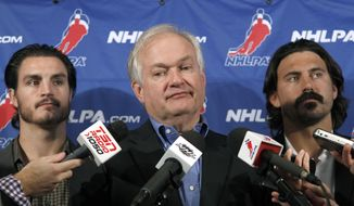 In this Sept. 12, 2012, file photo, National Hockey League Players' Association executive director Donald Fehr, center, is joined by players Kevin Westgath, left, and George Parros after meeting with NHL officials in New York. The NHLPA announces its decision whether to terminate the current collective bargaining agreement and set the clock ticking toward another potential work stoppage in 2020. (AP Photo/Mary Altaffer, File) **FILE**
