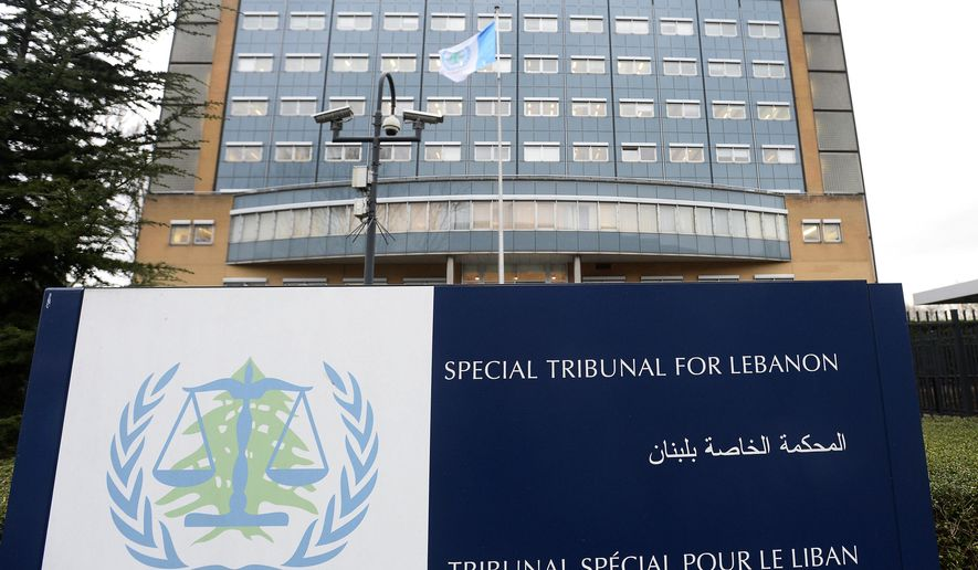 FILE - This Jan. 16, 2014, file photo, shows an exterior view of the Special Tribunal for Lebanon, in Leidschendam, Netherlands. The Tribunal, a U.N.-backed court based in the Netherlands, on Monday, Sept. 16, 2019, filed new charges including terrorism and intentional homicide against a Hezbollah fighter who also is accused of assassinating former Lebanese Prime Minister Rafiq Hariri. The Tribunal announced that a judge has confirmed a new five-count indictment accusing Salim Jamil Ayyash of three bombings targeting Lebanese politicians in 2004 and 2005. (Toussaint Kluiter/Pool, File)