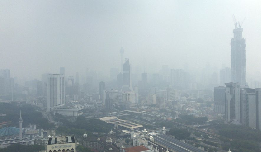 Kuala Lumpur city is shrouded with haze in Kuala Lumpur, Malaysia, Sunday, Sept. 15, 2019. Malaysia's government has banned open burning and conducted cloud-seeding in Sarawak on Thursday to induce rain to clear the choking haze. (AP Photo)