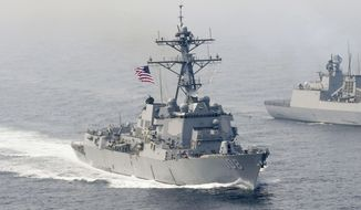 The U.S. Navy has been stepping up frequent warship passages through the South China Sea in a bid to assert freedom of navigation rights. (Associated Press/File)