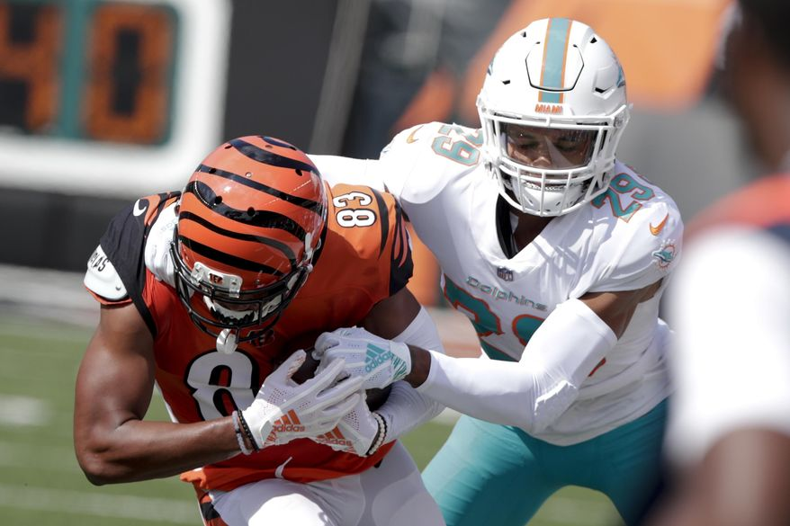 FILE - In this Oct. 7, 2018, file photo, Miami Dolphins' Minkah Fitzpatrick (29) tackles Cincinnati Bengals wide receiver Tyler Boyd (83) after a catch during the first half of an NFL football game in Cincinnati. A person familiar with the negotiations says Fitzpatrick has been traded to the Pittsburgh Steelers for a first-round draft pick in 2020. The person confirmed the trade to The Associated Press on condition of anonymity Monday, Sept. 16, 2019, night because the teams had not confirmed it. (AP Photo/Michael Conroy, File)