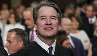 In this Feb. 5, 2019, file photo, Supreme Court Associate Justice Brett Kavanaugh watches as President Donald Trump arrives to give his State of the Union address. On Oct. 24, 2019, the U.S. Senate confirmed Justin Walker, a former clerk to Kavanaugh, to be a District Court judge for the Western District of Kentucky (Doug Mills/The New York Times via AP, Pool) ** FILE **