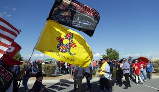 Supporters of President Donald Trump wait in line to enter the Santa Ana Star Center for a campaign rally, Monday, Sept. 16, 2019, in Rio Rancho, N.M. (AP Photo/Andres Leighton)