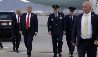 President Donald Trump walks to greet people after he arrives at Albuquerque International Sunport, Monday, Sept. 16, 2019, in Albuquerque, N.M. (AP Photo/Evan Vucci)