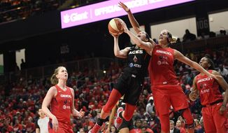 Las Vegas Aces guard Kelsey Plum, second from left, goes to the basket against Washington Mystics forward Elena Delle Donne, second from right, during the second half of Game 1 of a WNBA playoff basketball series, Tuesday, Sept. 17, 2019, in Washington. At left is Mystics center Emma Meesseman. The Mystics won 97-95. (AP Photo/Nick Wass) ** FILE **