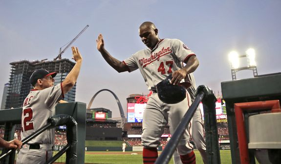 Washington Nationals' Howie Kendrick (47) is congratulated by bench coach Chip Hale after scoring during the second inning of the team's baseball game against the St. Louis Cardinals on Tuesday, Sept. 17, 2019, in St. Louis. (AP Photo/Jeff Roberson)  **FILE**