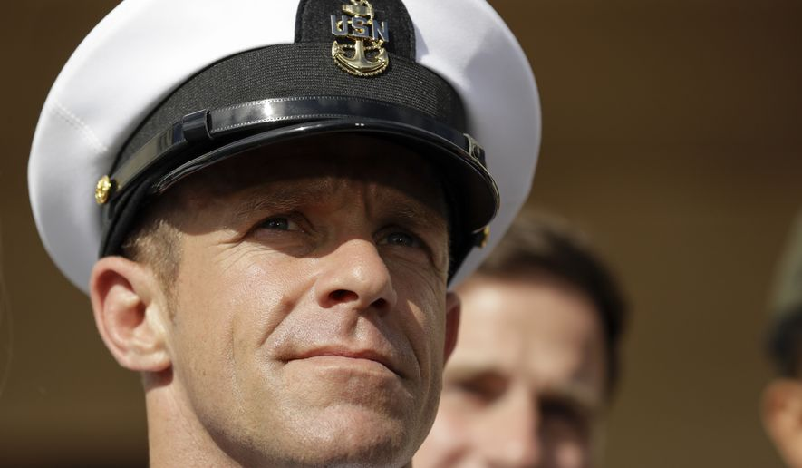 Navy Special Operations Chief Edward Gallagher leaves a military court on Naval Base San Diego. Gallagher, a Navy SEAL who was acquitted of murder by a military jury in July, has filed a lawsuit against two defense lawyers and a nonprofit legal defense group, all of whom had parted ways before the trial. (AP Photo/Gregory Bull, File)