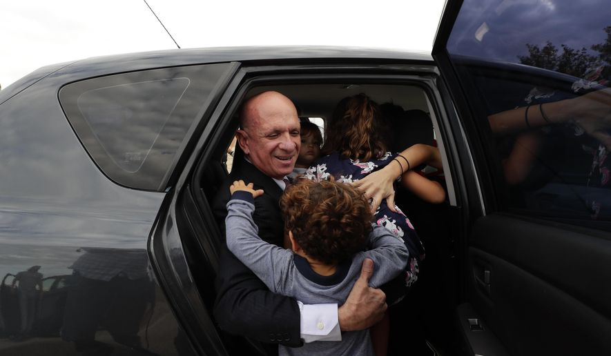 EDS NOTE : SPANISH LAW REQUIRES THAT THE FACES OF MINORS ARE MASKED IN PUBLICATIONS WITHIN SPAIN. Accompanied by family members, former Venezuelan military spy chief, retired Maj. Gen. Hugo Carvajal, center, enters into a car after walking out of prison in Estremera, outskirts of Madrid, Spain, Sunday, Sept. 15, 2019. Spain's National Court has rejected the extradition to the United States of a former Venezuelan military spy chief accused of drug smuggling and other charges. Within hours of Monday's ruling, the court released retired Maj. Gen. Hugo Carvajal, who claimed that the extradition request was politically motivated. (AP Photo/Manu Fernandez)