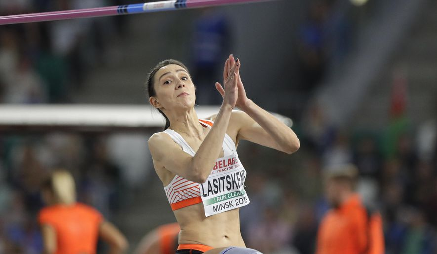 Mariya Lasitskene competes in the women's high jump final during the Match Europe against USA athletics competition on the Dinamo stadium in Minsk, Belarus, Tuesday, Sept. 10, 2019. (AP Photo/Sergei Grits)