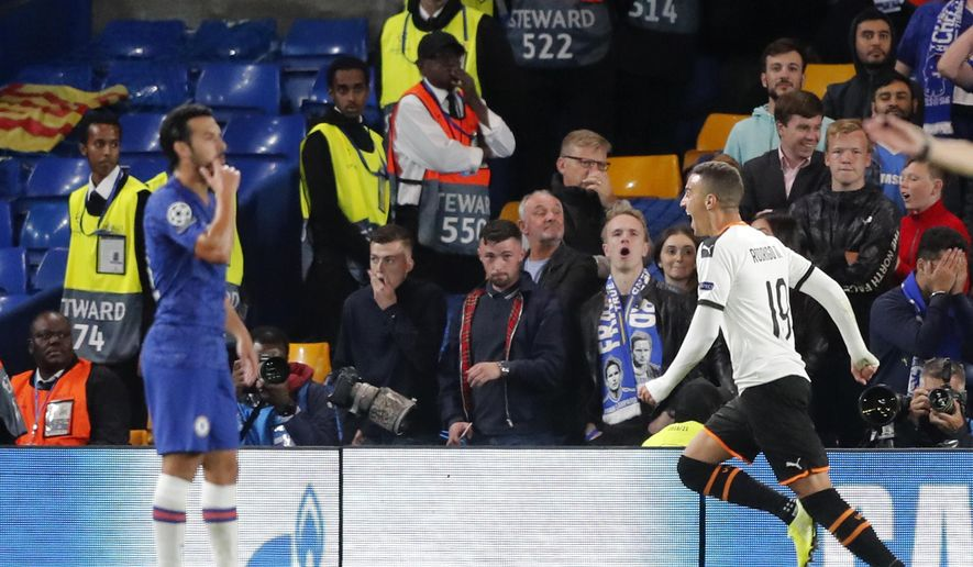 Valencia's Rodrigo Moreno, right, celebrates after scoring his side's opening goal during the Champions League Group H soccer match between Chelsea and Valencia at Stamford Bridge stadium in London, Tuesday, Sept. 17, 2019. (AP Photo/Frank Augstein)