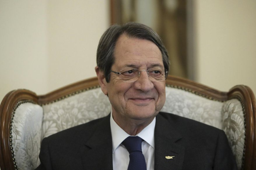 "Cyprus' president Nicos Anastasiades smiles during an interview with the Associated Press at the presidential palace in capital Nicosia, Cyprus, Tuesday Sept. 17, 2019. Anastasiades says Turkey's ""obsession"" to permanently station troops, secure military intervention rights and extend its influence over Turkish Cypriots in any peace deal is fanning fears that it wants to turn the island into a ""protectorate."" (AP Photo/Petros Karadjias)"