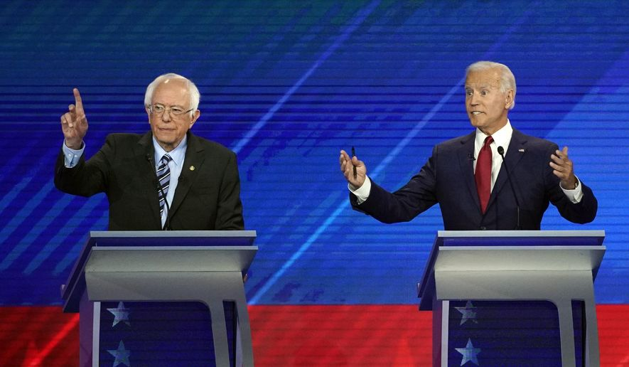 In this Thursday, Sept. 12, 2019, file photo, Sen. Bernie Sanders, I-Vt., left, and former Vice President Joe Biden speak during a Democratic presidential primary debate hosted by ABC at Texas Southern University in Houston. A feud between two leading Democratic presidential candidates, Biden and Sanders, is intensifying in the high-stakes fight for organized labor. The high-profile Democrats sought to undermine each other's credibility Tuesday as they faced hundreds of union members who gathered for an AFL-CIO conference in Philadelphia. (AP Photo/David J. Phillip, File)