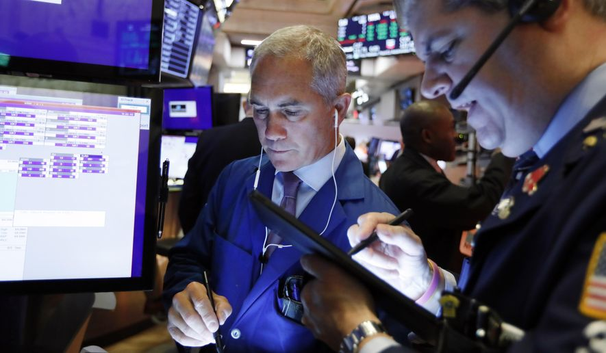 FILE - In this Sept. 13, 2019, file photo trader Timothy Nick, left, works on the floor of the New York Stock Exchange. The U.S. stock market opens at 9:30 a.m. EDT on Tuesday, Sept. 17. (AP Photo/Richard Drew)