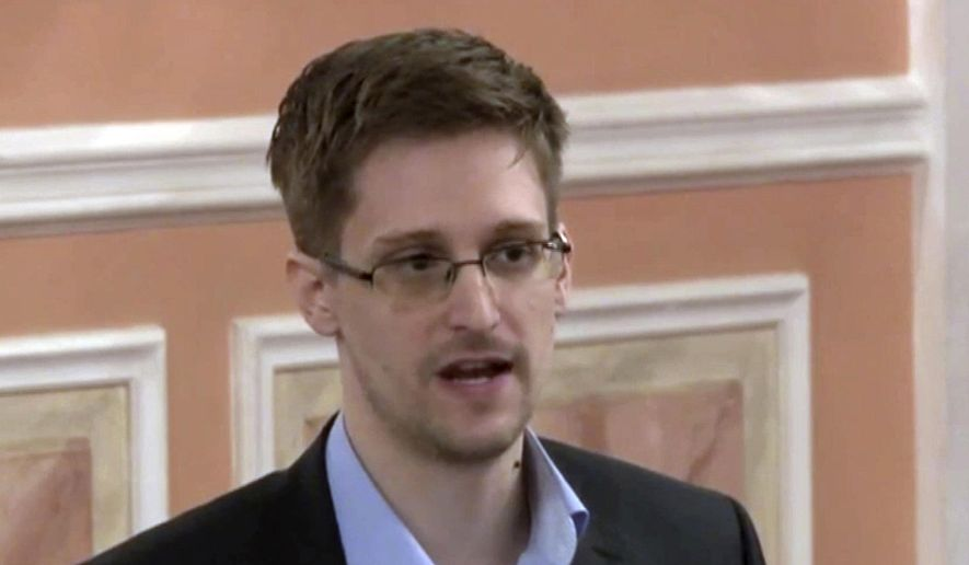 In this Oct. 11, 2013, file image made from video and released by WikiLeaks, former National Security Agency systems analyst Edward Snowden speaks in Moscow. (AP Photo)