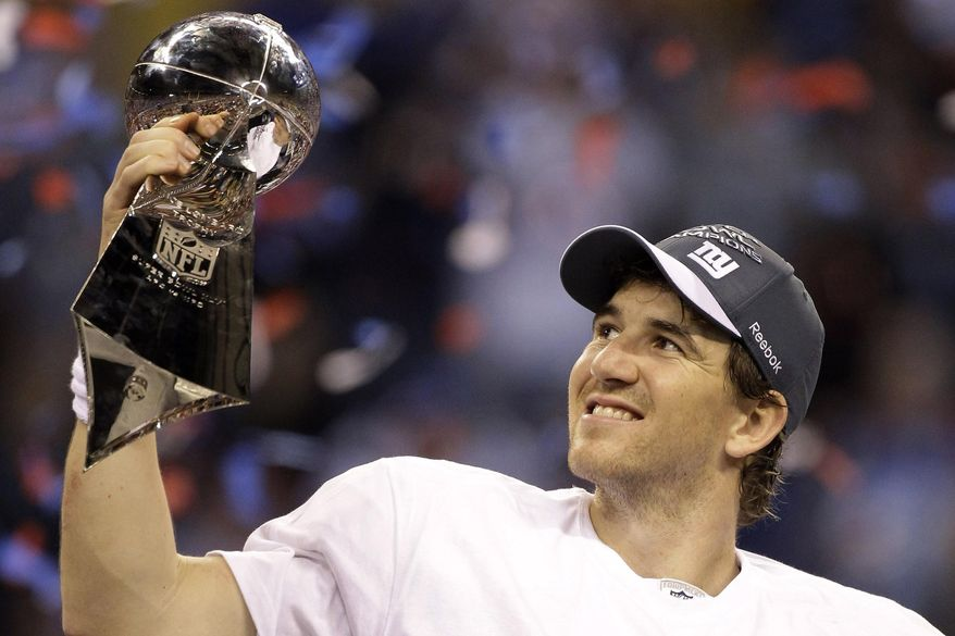 In this Feb. 5, 2012, file photo, New York Giants quarterback Eli Manning celebrates with the Vince Lombardi Trophy after the Giants' 21-17 win over the New England Patriots in the NFL Super Bowl XLVI football game in Indianapolis. Eli Manning's long and distinguished reign as the Giants' starting quarterback is seemingly over. Let the Daniel Jones era begin. Coach Pat Shurmur announced Tuesday, Sept. 17, 2019, that the No. 6 overall pick in the NFL draft is replacing two-time Super Bowl MVP as the Giants' quarterback, beginning Sunday at Tampa Bay.(AP Photo/Chris O'Meara) ** FILE **