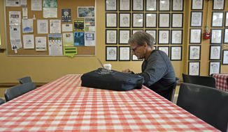 In this Sept. 11, 2019 photo, Barry Marchinkoski sits at a table for breakfast at the St. Vincent de Paul soup kitchen in Middletown, Conn. Marchinkoski has been in-and-out of prison and jail, while also being homeless, for most of his life. Nearly half of the people entering homeless shelters in Connecticut in the last three years have spent time inside a state prison or jail at some point in their lives, according to data collected by the state. (AP Photo/Chris Ehrmann)