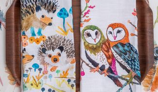 This photo provided by Betsy Olmsted Design Studio shows some of the Saratoga Springs, N.Y.-based artist and designer's designs. Betsy Olmstead planned to become a naturalist. Now she translates that early passion for living things into a delightful collection of watercolor, gouache and ink drawings for table linens, pillows, wallpaper and fabric by the yard. There are woodland creatures like foxes, hedgehogs and turkeys on offer as tea towels, for example, as well as an intriguing wallpaper pattern called Curio on which glass cloches hold beautifully-rendered mushrooms, coral, antlers and moths as well as fungi and flora. (Elizabeth Pedinotti Haynes/Betsy Olmsted Design Studio via AP)