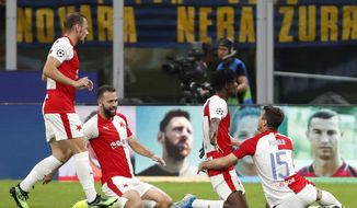 Slavia's Peter Olayinka, 2nd right, celebrates with teammates after scoring his sides first goal during the Champions League group F soccer match between Inter Milan and Slavia Prague at the San Siro stadium in Milan, Italy, Tuesday, Sept. 17, 2019. (AP Photo/Antonio Calanni)