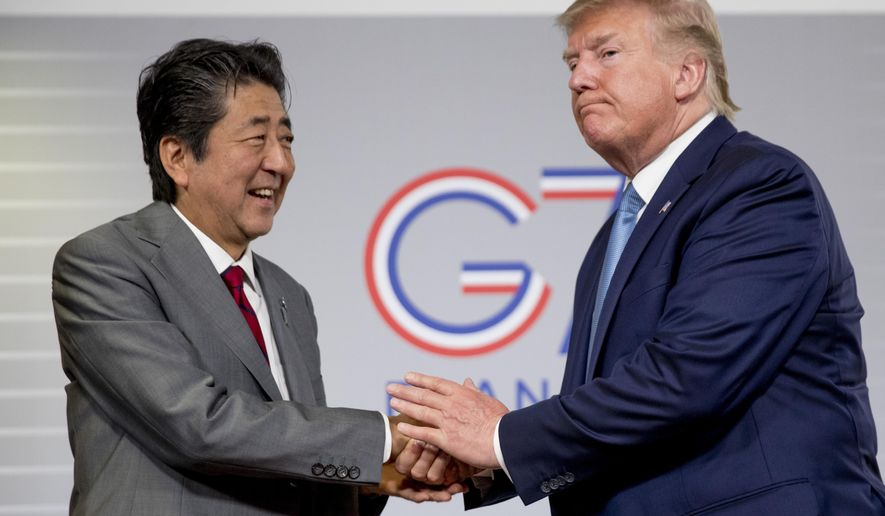 In this Aug. 25, 2019, photo, U.S President Donald Trump and Japanese Prime Minister Shinzo Abe shake hands following a news conference at the G-7 summit in Biarritz, France, to announce that the U.S. and Japan have agreed in principle on a new trade agreement. On Tuesday, Sept. 17, 2019, officials in Japan appear wary over the prospects for a trade deal with the U.S. after President Donald Trump said he was prepared to sign a pact soon. (AP Photo/Andrew Harnik, File)
