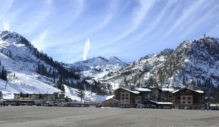 """FILE - This Dec. 16, 2011 file photo shows the base village at Squaw Valley in Olympic Valley, Calif. A proposal to connect two Lake Tahoe ski resorts with a 2.2-mile-long (3.5-kilometer-long) gondola has moved closer to final approval. Placer County's approval of the project on Tuesday is one of the """"last crucial steps"""" toward linking Squaw Valley and Alpine Meadows, said Ron Cohen, president of Squaw Valley Alpine Meadows. The Sierra Sun reports the gondola with eight-passenger cars would transport up to 1,400 people an hour on a 16-minute trip between the bases of the co-owned, neighboring resorts northwest of Tahoe City, California. (Tim Dunn/The Reno Gazette-Journal via AP,File)"""