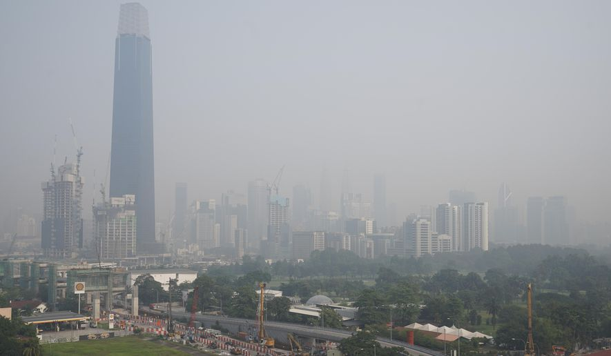Kuala Lumpur city is shrouded with haze in Kuala Lumpur, Malaysia, Tuesday, Sept. 17, 2019. More then 100 schools was closed Tuesday after the air quality in the area continued to trend at very unhealthy levels. (AP Photo/Vincent Thian)