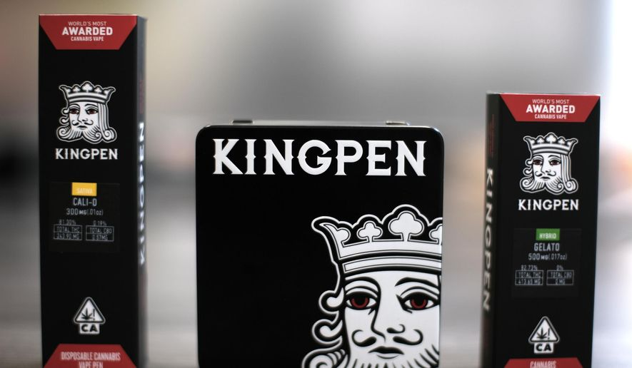 This Tuesday, Sept. 10, 2019, photo shows the new Kingpen packaging, center, flanked by the previous packaging in Los Angeles. Bootleggers eager to profit off unsuspecting consumers are mimicking popular vape brands, pairing replica packaging churned out in Chinese factories with untested, and possibly adulterated, cannabis oil produced in the state's vast underground market. As a result of the bootleggers, the company had to change and innovate their new packaging. (AP Photo/Richard Vogel)