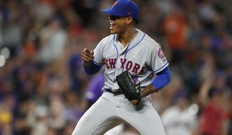 New York Mets starting pitcher Marcus Stroman reacts after catcher Wilson Ramos threw out Colorado Rockies' Charlie Blackmon, who tried to steal second base during the seventh inning of a baseball game Tuesday, Sept. 17, 2019, in Denver. (AP Photo/David Zalubowski)
