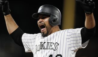 Colorado Rockies' Antonio Senzatela reacts after hitting a single, -his first hit of the season, to drive in two runs off New York Mets starting pitcher Steven Matz in the fourth inning of a baseball game Monday, Sept. 16, 2019, in Denver. (AP Photo/David Zalubowski)