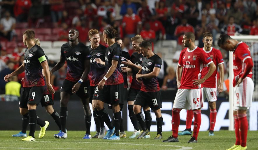 Leipzig's Timo Werner celebrates with teammates scoring the second goal during the Champions League group G soccer match between Benfica and Leipzig at the Luz stadium in Lisbon, Tuesday, Sept. 17, 2019. (AP Photo/Armando Franca)