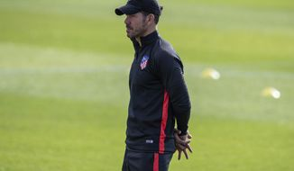 Atletico Madrid coach Diego Simeone attends a training session in Majadahonda, outskirts of Madrid, Spain, Tuesday, Sept. 17, 2019. Atletico Madrid will play its Champions League soccer match against Juventus on Wednesday. (AP Photo/Bernat Armangue)