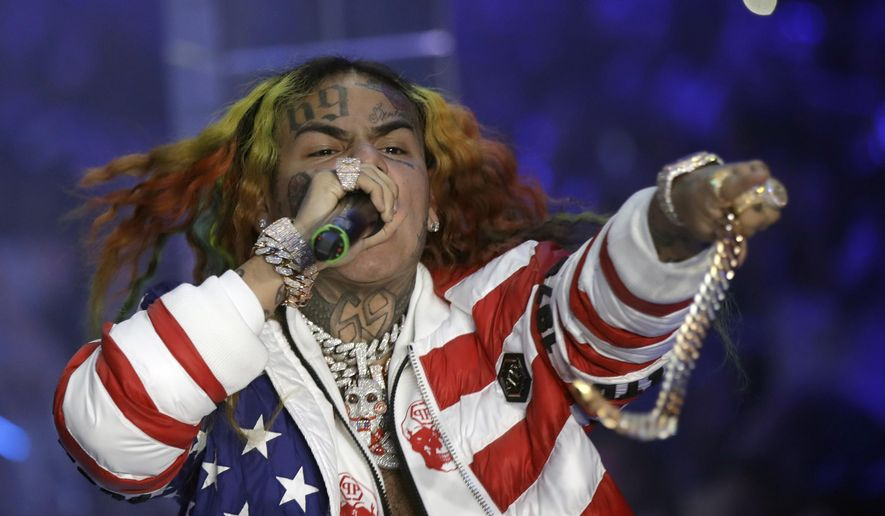 FILE- In this Sept. 21, 2018, file photo rapper Daniel Hernandez, known as Tekashi 6ix9ine, performs during the Philipp Plein women's 2019 Spring-Summer collection, Milan, Italy. Hernandez is set to testify Tuesday, Sept. 17, 2019, as a prosecution witness at the federal trial of alleged members of a violent New York City gang.  (AP Photo/Luca Bruno, File)