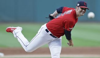 Cleveland Indians starting pitcher Adam Plutko delivers in the first inning of the team's baseball game against the Detroit Tigers, Tuesday, Sept. 17, 2019, in Cleveland. (AP Photo/Tony Dejak)