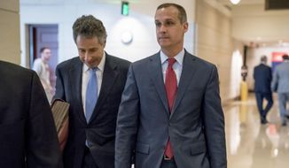 In this March 8, 2019, file photo, President Donald Trump's former campaign manager Corey Lewandowski, right, and his lawyer Peter Chavkin, left, arrive to meet behind closed doors with the House Intelligence Committee, at the Capitol in Washington. Lewandowski, is expected to testify publicly before the House Judiciary Committee on Tuesday, Sept. 17, in what the panel is labeling its first official impeachment hearing. (AP Photo/Andrew Harnik) **FILE**