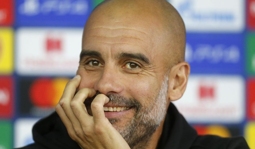 Manchester City's coach Pep Guardiola attends a press conference ahead of the Group C Champions League soccer match between Manchester City and FC Shakhtar Donetsk in Kharkiv, Ukraine, Tuesday, Sept. 17, 2019. (AP Photo/Efrem Lukatsky)