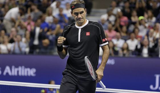 Roger Federer, of Switzerland, reacts during a match against Grigor Dimitrov, of Bulgaria, during the quarterfinals of the U.S. Open tennis tournament Tuesday, Sept. 3, 2019, in New York. (AP Photo/Seth Wenig)